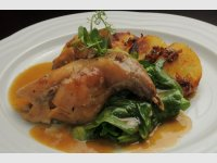Larded leg of rabbit, served with steamed spinach